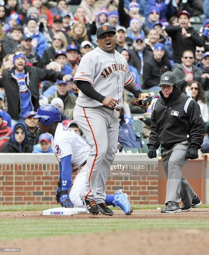 <a gi-track='captionPersonalityLinkClicked' href=/galleries/search?phrase=Alfonso+Soriano&family=editorial&specificpeople=202251 ng-click='$event.stopPropagation()'>Alfonso Soriano</a> #12 of the Chicago Cubs steals third base as <a gi-track='captionPersonalityLinkClicked' href=/galleries/search?phrase=Pablo+Sandoval&family=editorial&specificpeople=803207 ng-click='$event.stopPropagation()'>Pablo Sandoval</a> #48 of the San Francisco Giants reacts during the second inning on April 13, 2013 at Wrigley Field in Chicago, Illinois.