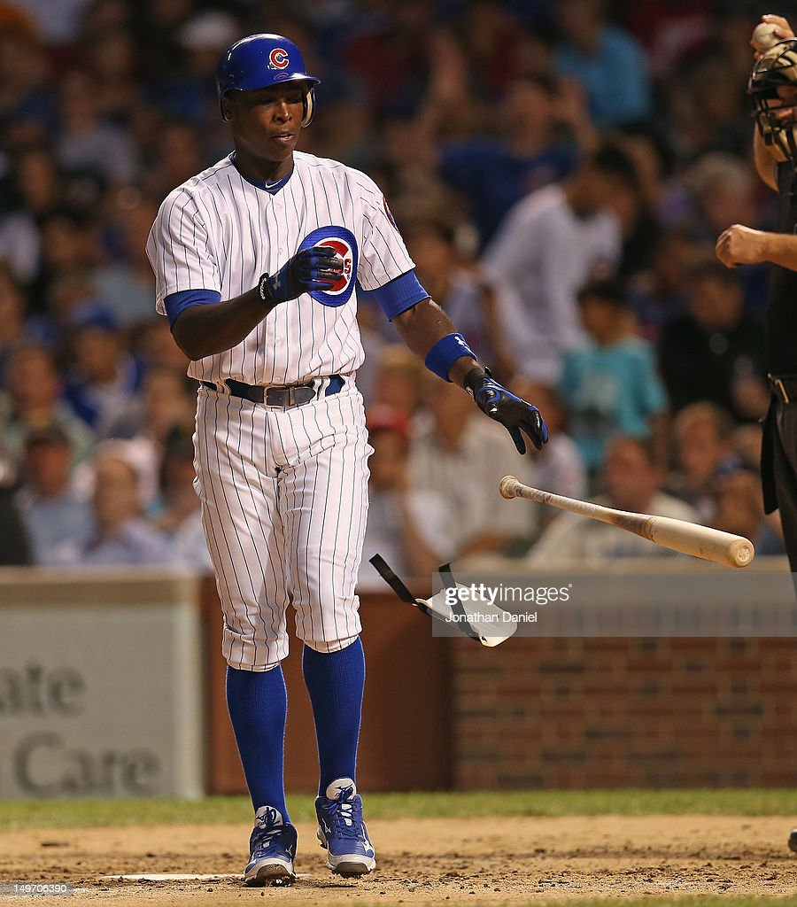 Alfonso Soriano of the Chicago Cubs throws his bat and shin guard after striking out against AJ Burnett of the Pittsburgh Pirates at Wrigley Field on...
