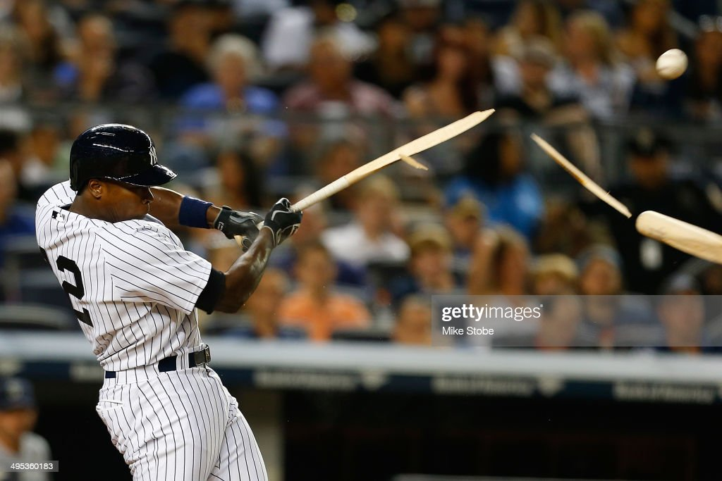 Alfonso Soriano #12 of the New York Yankees breaks his bat fouling the ball off in the sixth inning against the Seattle Mariners at Yankee Stadium on June 2, 2014 in the Bronx borough of New York City.