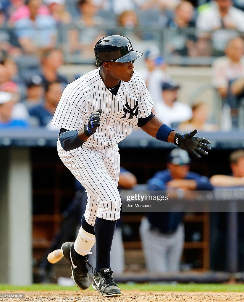 Alfonso Soriano #12 of the New York Yankees celebrates his ninth inning game winning base hit against the Tampa Bay Rays at Yankee Stadium on July 28, 2013 in the Bronx borough of New York City.
