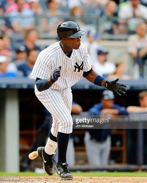 Alfonso Soriano of the New York Yankees celebrates his ninth inning game winning base hit against the Tampa Bay Rays at Yankee Stadium on July 28...