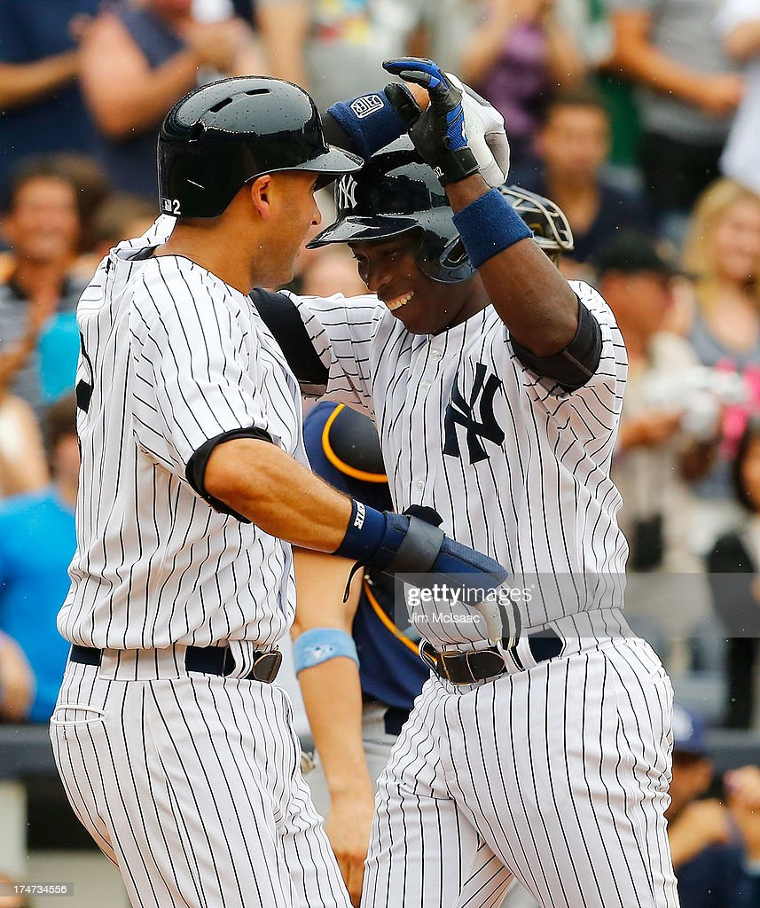 <a gi-track='captionPersonalityLinkClicked' href=/galleries/search?phrase=Alfonso+Soriano&family=editorial&specificpeople=202251 ng-click='$event.stopPropagation()'>Alfonso Soriano</a> #12 of the New York Yankees celebrates his third inning two run home run against the Tampa Bay Rays with teammate <a gi-track='captionPersonalityLinkClicked' href=/galleries/search?phrase=Derek+Jeter&family=editorial&specificpeople=167125 ng-click='$event.stopPropagation()'>Derek Jeter</a> #2 at Yankee Stadium on July 28, 2013 in the Bronx borough of New York City.