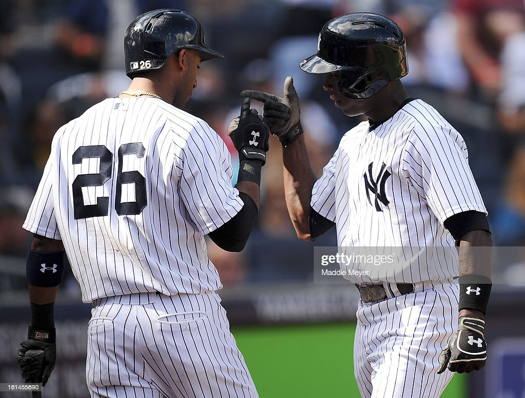 <a gi-track='captionPersonalityLinkClicked' href=/galleries/search?phrase=Alfonso+Soriano&family=editorial&specificpeople=202251 ng-click='$event.stopPropagation()'>Alfonso Soriano</a> #12 of the New York Yankees celebrates with <a gi-track='captionPersonalityLinkClicked' href=/galleries/search?phrase=Eduardo+Nunez&family=editorial&specificpeople=4900197 ng-click='$event.stopPropagation()'>Eduardo Nunez</a> after hitting a home run during the sixth inning against the San Francisco Giants during interleague play on September 21, 2013 at Yankee Stadium in the Bronx borough of New York City.