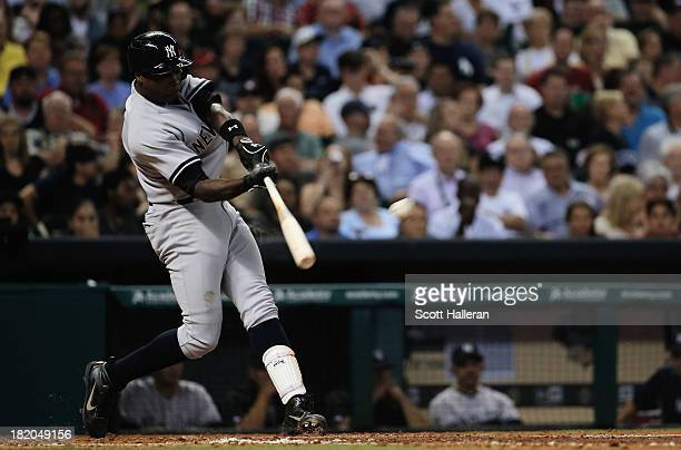Alfonso Soriano of the New York Yankees connects on a double in the sixth inning against the Houston Astros at Minute Maid Park on September 27 2013...