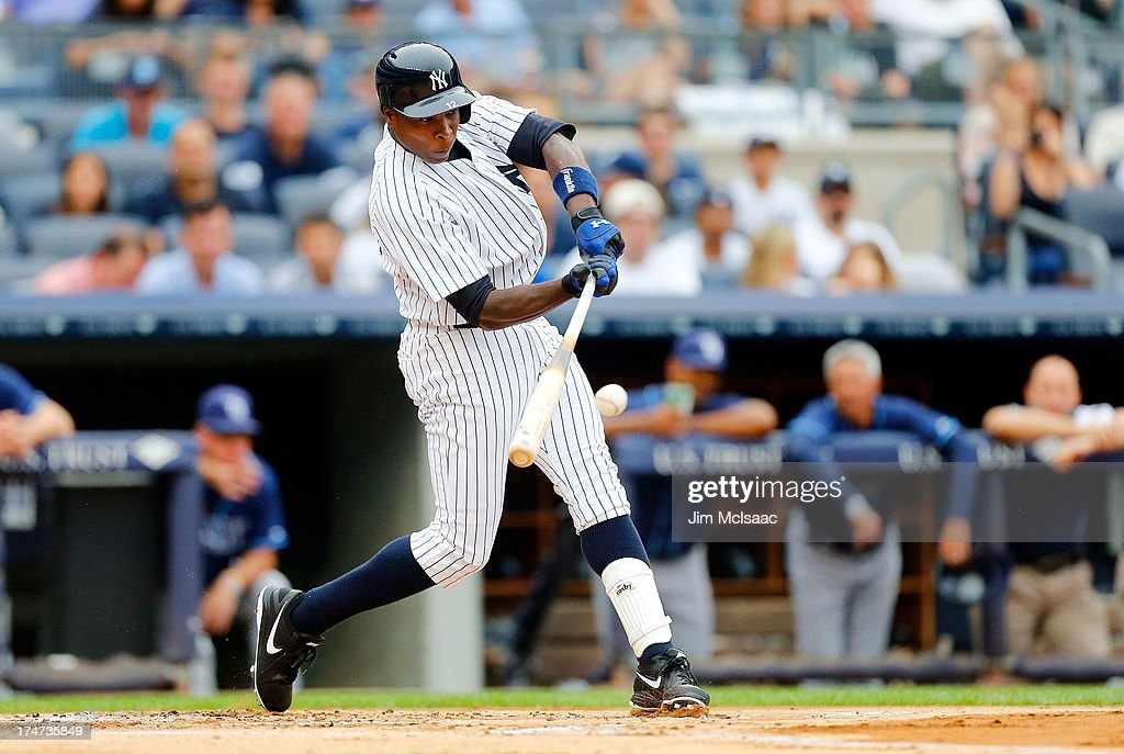 <a gi-track='captionPersonalityLinkClicked' href=/galleries/search?phrase=Alfonso+Soriano&family=editorial&specificpeople=202251 ng-click='$event.stopPropagation()'>Alfonso Soriano</a> #12 of the New York Yankees connects on a first inning base hit, his first hit since rejoining the Yankees, against the Tampa Bay Rays at Yankee Stadium on July 28, 2013 in the Bronx borough of New York City.