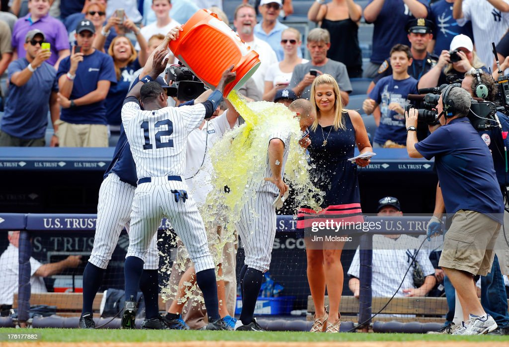Alfonso Soriano #12 of the New York Yankees dumps Gatorade on teammate Brett Gardner #11 in celebration of Gardner's game winning home run in the ninth inning against the Detroit Tigers at Yankee Stadium on August 11, 2013 in the Bronx borough of New York City.