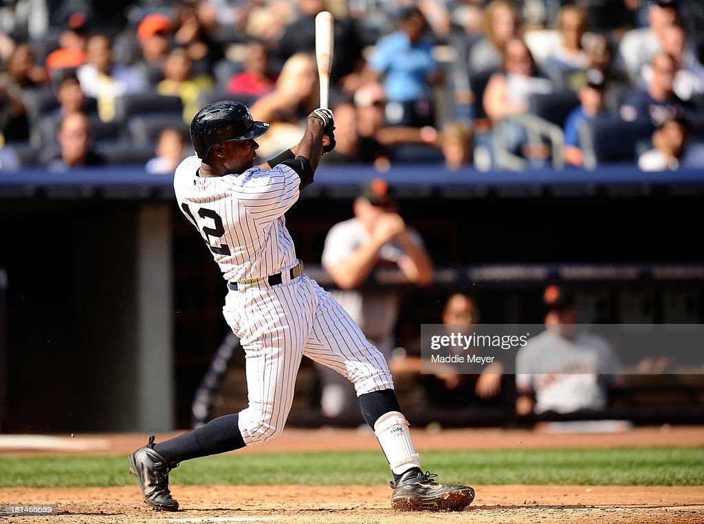 <a gi-track='captionPersonalityLinkClicked' href=/galleries/search?phrase=Alfonso+Soriano&family=editorial&specificpeople=202251 ng-click='$event.stopPropagation()'>Alfonso Soriano</a> #12 of the New York Yankees hits a home run during the sixth inning against the San Francisco Giants during interleague play on September 21, 2013 at Yankee Stadium in the Bronx borough of New York City.
