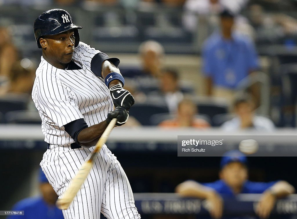 Alfonso Soriano #12 of the New York Yankees hits a two-run home run in the eighth inning breaking a 2-2 tie against the Toronto Blue Jays in a MLB baseball game at Yankee Stadium on August 21, 2013 in the Bronx borough of New York City. The Yankees defeated the Blue Jays 4-2.