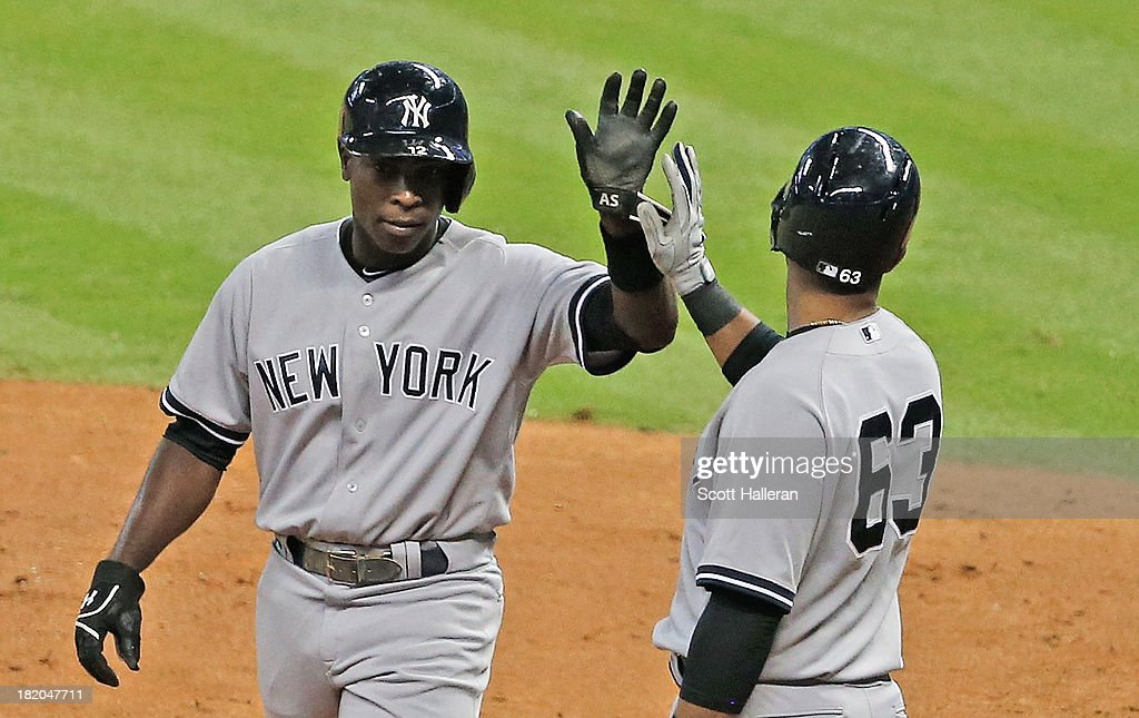 <a gi-track='captionPersonalityLinkClicked' href=/galleries/search?phrase=Alfonso+Soriano&family=editorial&specificpeople=202251 ng-click='$event.stopPropagation()'>Alfonso Soriano</a> #12 of the New York Yankees is greeted at home plate by Zoilo Almonte #63 after Soriano scored a run in the fourth inning against the Houston Astros at Minute Maid Park on September 27, 2013 in Houston, Texas.