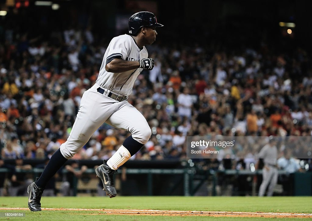 <a gi-track='captionPersonalityLinkClicked' href=/galleries/search?phrase=Alfonso+Soriano&family=editorial&specificpeople=202251 ng-click='$event.stopPropagation()'>Alfonso Soriano</a> #12 of the New York Yankees legs out a double in the sixth inning against the Houston Astros at Minute Maid Park on September 27, 2013 in Houston, Texas.