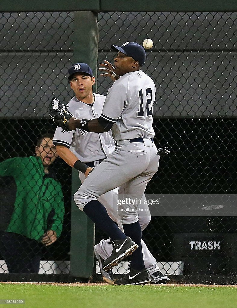 Alfonso Soriano of the New York Yankees misplays a ball hit off the wall by Gordon Beckham of the Chicago White Sox next to teammate Jacoby Ellsbury...