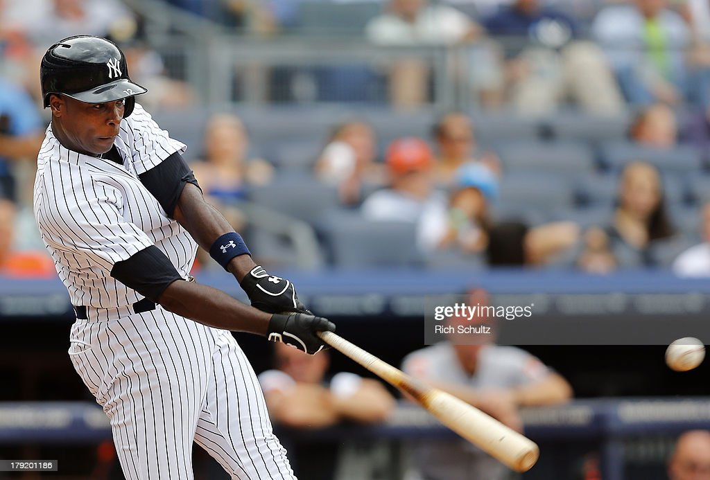 <a gi-track='captionPersonalityLinkClicked' href=/galleries/search?phrase=Alfonso+Soriano&family=editorial&specificpeople=202251 ng-click='$event.stopPropagation()'>Alfonso Soriano</a> #12 of the New York Yankees singles in the third inning scoring Brett Gardner #11 against the Baltimore Orioles in a MLB baseball game at Yankee Stadium on September 1, 2013 in the Bronx borough of New York City.