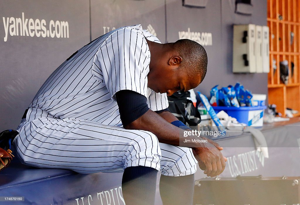 <a gi-track='captionPersonalityLinkClicked' href=/galleries/search?phrase=Alfonso+Soriano&family=editorial&specificpeople=202251 ng-click='$event.stopPropagation()'>Alfonso Soriano</a> #12 of the New York Yankees sits in the dugout during the eighth inning against the Tampa Bay Rays at Yankee Stadium on July 27, 2013 in the Bronx borough of New York City.