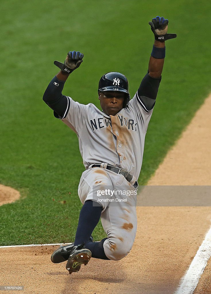 <a gi-track='captionPersonalityLinkClicked' href=/galleries/search?phrase=Alfonso+Soriano&family=editorial&specificpeople=202251 ng-click='$event.stopPropagation()'>Alfonso Soriano</a> #12 of the New York Yankees slides into home to score a run on a wild pitch in the 1st inning against the Chicago White Sox at U.S. Cellular Field on August 6, 2013 in Chicago, Illinois.
