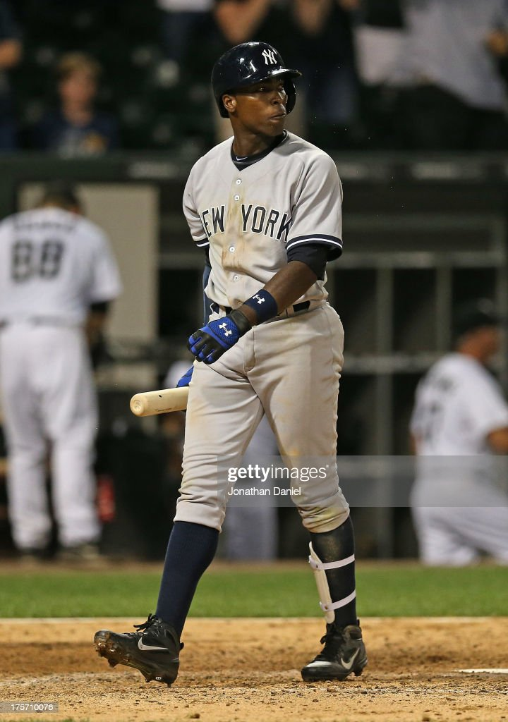 <a gi-track='captionPersonalityLinkClicked' href=/galleries/search?phrase=Alfonso+Soriano&family=editorial&specificpeople=202251 ng-click='$event.stopPropagation()'>Alfonso Soriano</a> #12 of the New York Yankees walks back to the dugout after striking out to end the game against the Chicago White Sox at U.S. Cellular Field on August 6, 2013 in Chicago, Illinois. The White Sox defeated the Yankees 3-2.