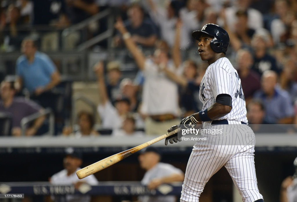 Alfonso Soriano #12 of the Yankees 2 run home run in the 8th inning of the New York Yankees game against the Toronto Blue Jays at Yankee Stadium on August 21, 2013 in the Bronx borough of New York City. The Yankees won 4-2.