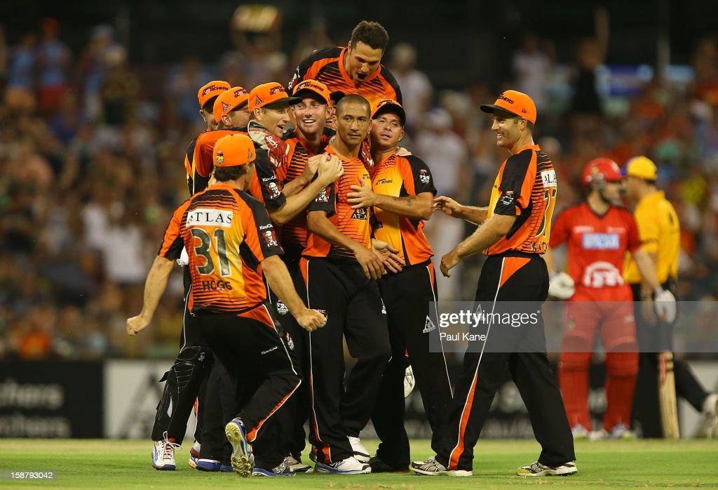 <a gi-track='captionPersonalityLinkClicked' href=/galleries/search?phrase=Alfonso+Thomas&family=editorial&specificpeople=2644222 ng-click='$event.stopPropagation()'>Alfonso Thomas</a> of the Scorchers is congratulated after dismissing Marion Samuels of the Renegades during the Big Bash League match between the Perth Scorchers and the Melbourne Renegads at WACA on December 29, 2012 in Perth, Australia.