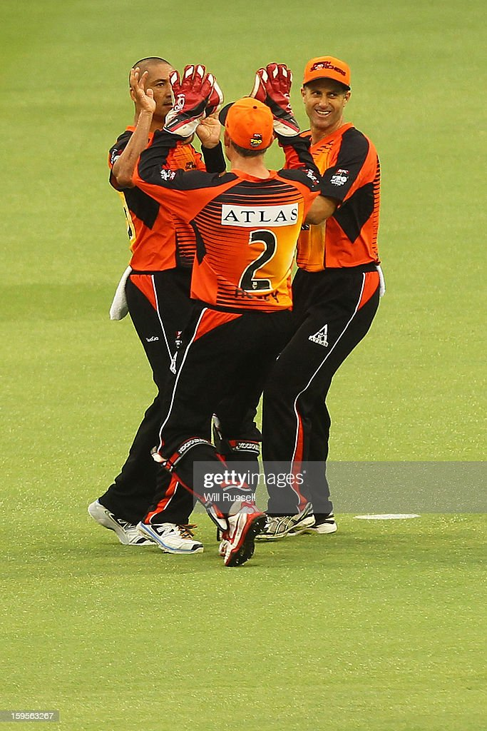 Alfonso Thomas of the Scorchers is congratulated after taking a catch off Luke Wright during the Big Bash League semi-final match between the Perth Scorchers and the Melbourne Stars at the WACA on January 16, 2013 in Perth, Australia.