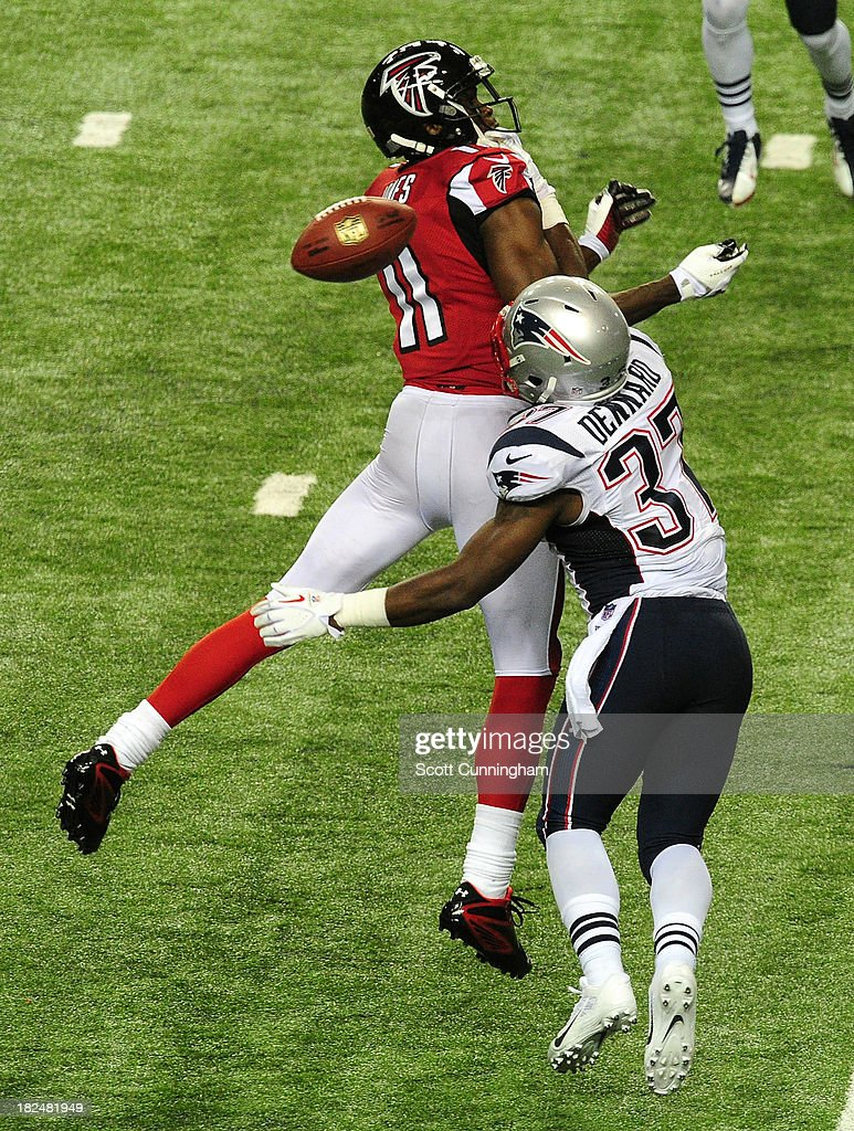 <a gi-track='captionPersonalityLinkClicked' href=/galleries/search?phrase=Alfonzo+Dennard&family=editorial&specificpeople=5651216 ng-click='$event.stopPropagation()'>Alfonzo Dennard</a> #37 of the New England Patriots breaks up a pass for <a gi-track='captionPersonalityLinkClicked' href=/galleries/search?phrase=Julio+Jones&family=editorial&specificpeople=5509837 ng-click='$event.stopPropagation()'>Julio Jones</a> #11 of the Atlanta Falcons at the Georgia Dome on September 29, 2013 in Atlanta, Georgia.