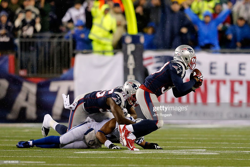 Alfonzo Dennard #37 of the New England Patriots intercepts a pass by Andrew Luck #12 of the Indianapolis Colts in the first quarter during the AFC Divisional Playoff game at Gillette Stadium on January 11, 2014 in Foxboro, Massachusetts.