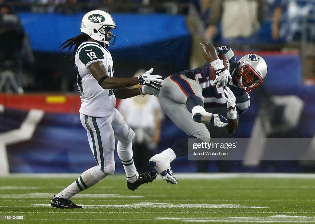<a gi-track='captionPersonalityLinkClicked' href=/galleries/search?phrase=Alfonzo+Dennard&family=editorial&specificpeople=5651216 ng-click='$event.stopPropagation()'>Alfonzo Dennard</a> #37 of the New England Patriots intercepts a pass in front of <a gi-track='captionPersonalityLinkClicked' href=/galleries/search?phrase=Clyde+Gates&family=editorial&specificpeople=8040203 ng-click='$event.stopPropagation()'>Clyde Gates</a> #19 of the New York Jets in the fourth quarter during the game at Gillette Stadium on September 12, 2013 in Foxboro, Massachusetts.