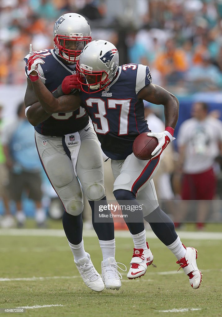 Alfonzo Dennard #37 of the New England Patriots reacts after his fumble recovery in the first half of play against the Miami Dolphins during a game at Sun Life Stadium on September 7, 2014 in Miami Gardens, Florida.