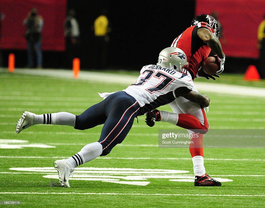<a gi-track='captionPersonalityLinkClicked' href=/galleries/search?phrase=Alfonzo+Dennard&family=editorial&specificpeople=5651216 ng-click='$event.stopPropagation()'>Alfonzo Dennard</a> #37 of the New England Patriots tackles <a gi-track='captionPersonalityLinkClicked' href=/galleries/search?phrase=Julio+Jones&family=editorial&specificpeople=5509837 ng-click='$event.stopPropagation()'>Julio Jones</a> #11 of the Atlanta Falcons at the Georgia Dome on September 29, 2013 in Atlanta, Georgia.