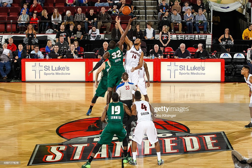 Alfred Aboya of the Reno Bighorns and Quinton Doggett of the Idaho Stampede go up for the opening tip off of an NBA DLeague game on November 28 2014...