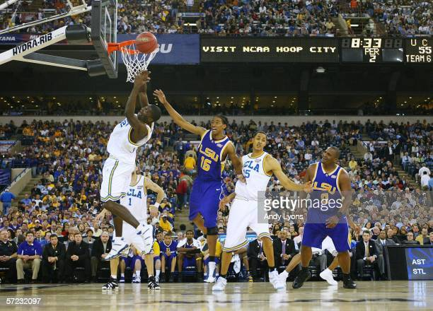Alfred Aboya of the UCLA Bruins attempts to bring down a rebound against the LSU Tigers defense during the semifinal game of the NCAA Men's Final...