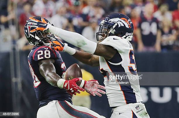 Alfred Blue of the Houston Texans and Brandon Marshall of the Denver Broncos battle for the football in the first half of their game at NRG Stadium...