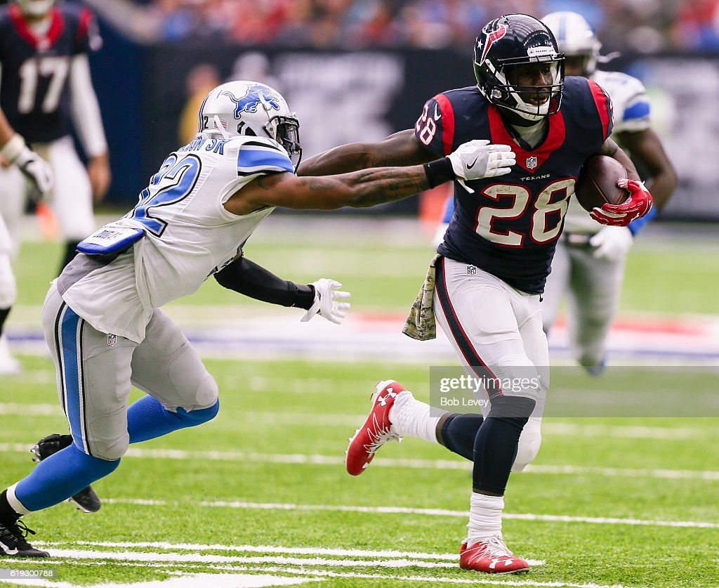 Alfred Blue #28 of the Houston Texans fends off Tavon Wilson #32 of the Detroit Lions in the fourth quarter at NRG Stadium on October 30, 2016 in Houston, Texas.