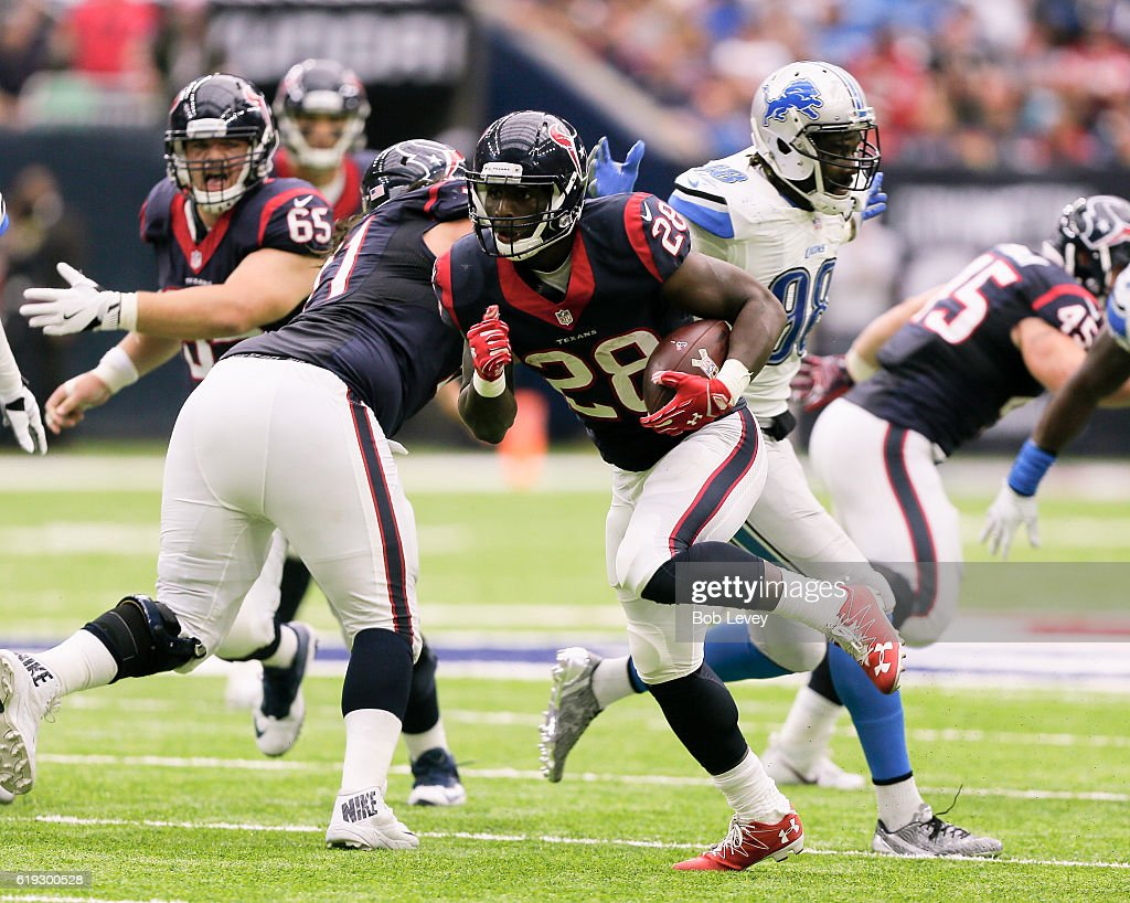 Alfred Blue #28 of the Houston Texans rushes with the ball against the Detroit Lions at NRG Stadium on October 30, 2016 in Houston, Texas.