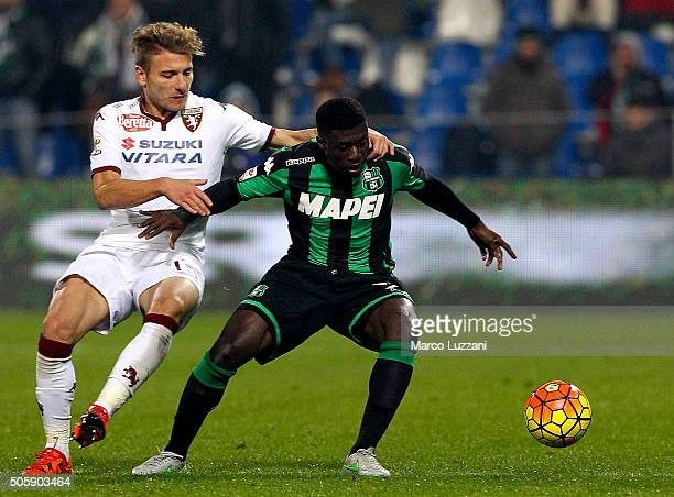 Alfred Duncan of US Sassuolo Calcio is challenged by Ciro Immobile of Torino FC during the Serie A match betweeen US Sassuolo Calcio and Torino FC at...