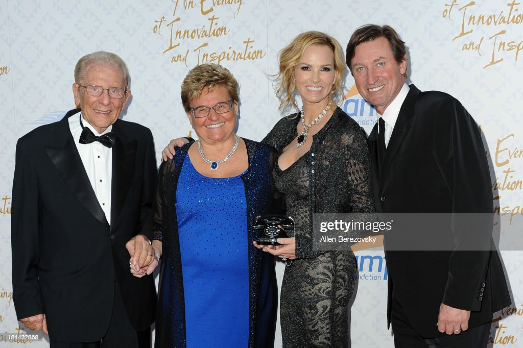 Alfred E. Mann, Claudia Mann, Janet Gretzky, and <a gi-track='captionPersonalityLinkClicked' href=/galleries/search?phrase=Wayne+Gretzky+-+Ice+Hockey+Player&family=editorial&specificpeople=157520 ng-click='$event.stopPropagation()'>Wayne Gretzky</a> attend the 10th annual <a gi-track='captionPersonalityLinkClicked' href=/galleries/search?phrase=Alfred+Mann&family=editorial&specificpeople=2255821 ng-click='$event.stopPropagation()'>Alfred Mann</a> Foundation Gala at 9900 Wilshire Blvd on October 13, 2013 in Beverly Hills, California.