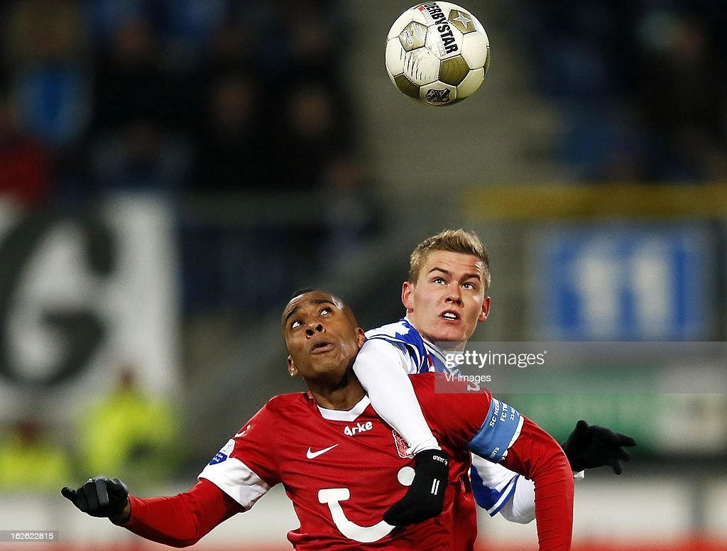 Alfred Finnbogason (R), Leroy Fer (L) during the Dutch Eredivisie Match between SC Heerenveen and FC Twente at the Abe Lenstra Stadium on february 23, 2013 in Heerenveen, The Netherlands