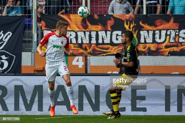 Alfred Finnbogason of Augsburg and Jeremy Toljan of Dortmund battle for the ball during the Bundesliga match between FC Augsburg and Borussia...