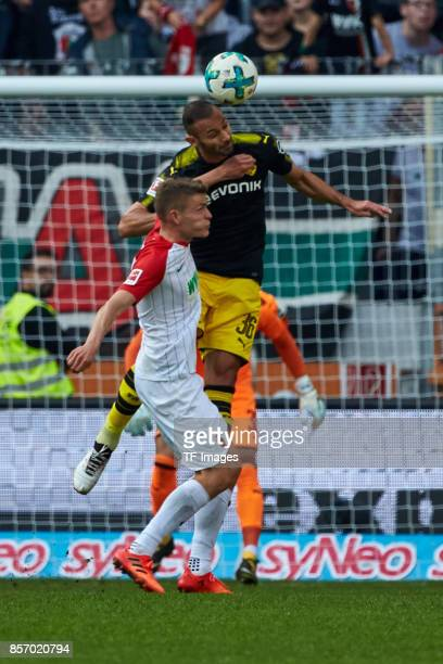 Alfred Finnbogason of Augsburg and Oemer Toprak of Dortmund battle for the ball during the Bundesliga match between FC Augsburg and Borussia Dortmund...