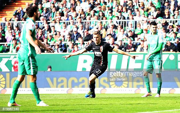 Alfred Finnbogason of Augsburg celebrates after scoring his teams first goal during the Bundesliga match between Werder Bremen and FC Augsburg at...