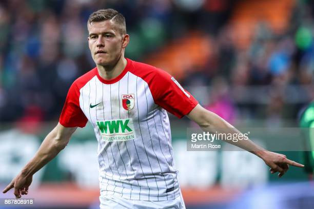 Alfred Finnbogason of Augsburg celebrates after scoring penalty shot to make it 02 during the Bundesliga match between SV Werder Bremen and FC...