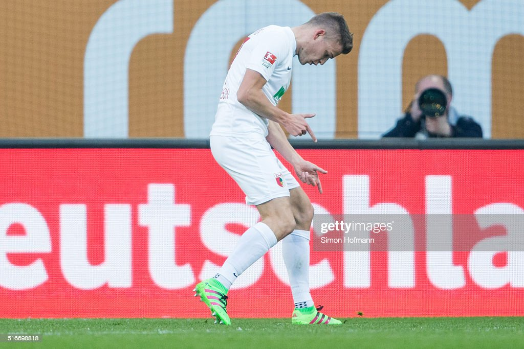 Alfred Finnbogason of Augsburg celebrates his team's first goal during the Bundesliga match between FC Augsburg and Borussia Dortmund at SGL Arena on March 20, 2016 in Augsburg, Germany.