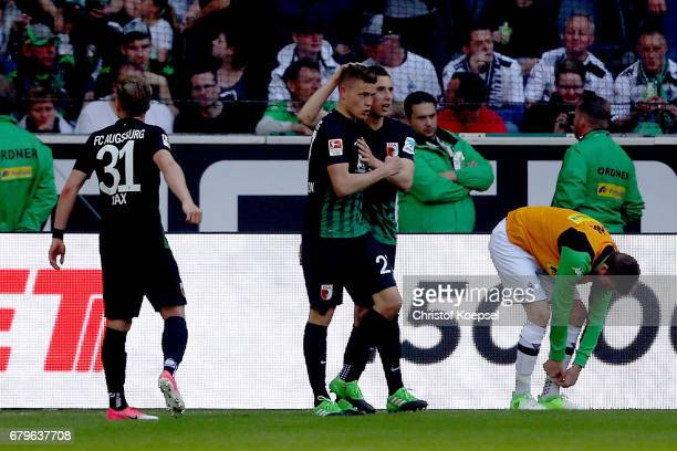 Alfred Finnbogason of Augsburg celebrates the first goal with Dominik Kohr of Augsburg during the Bundesliga match between Borussia Moenchengladbach...
