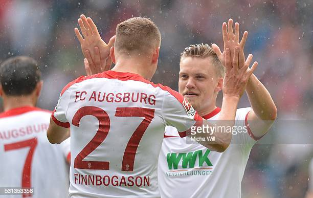 Alfred Finnbogason of Augsburg celebrates with teammate Philipp Max of Augsburg after scoring the opening/first goal during the Bundesliga match...