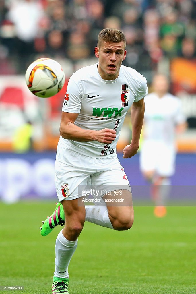 Alfred Finnbogason of Augsburg runs with the ball during the Bundesliga match between FC Augsburg and Borussia Moenchengladbach at WWK Arena on February 28, 2016 in Augsburg, Germany.