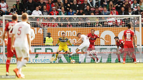 Alfred Finnbogason of Augsburg scores the first goal during the Bundesliga match between FC Augsburg and VfB Stuttgart at WWK Arena on April 16 2016...