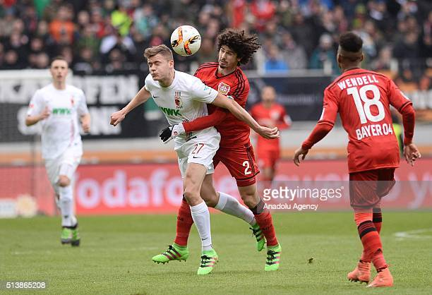 Alfred Finnbogason of Augsburg vies for the ball against Andre Ramalho of Bayer 04 Leverkusen during the Bundesliga soccer match between FC Augsburg...