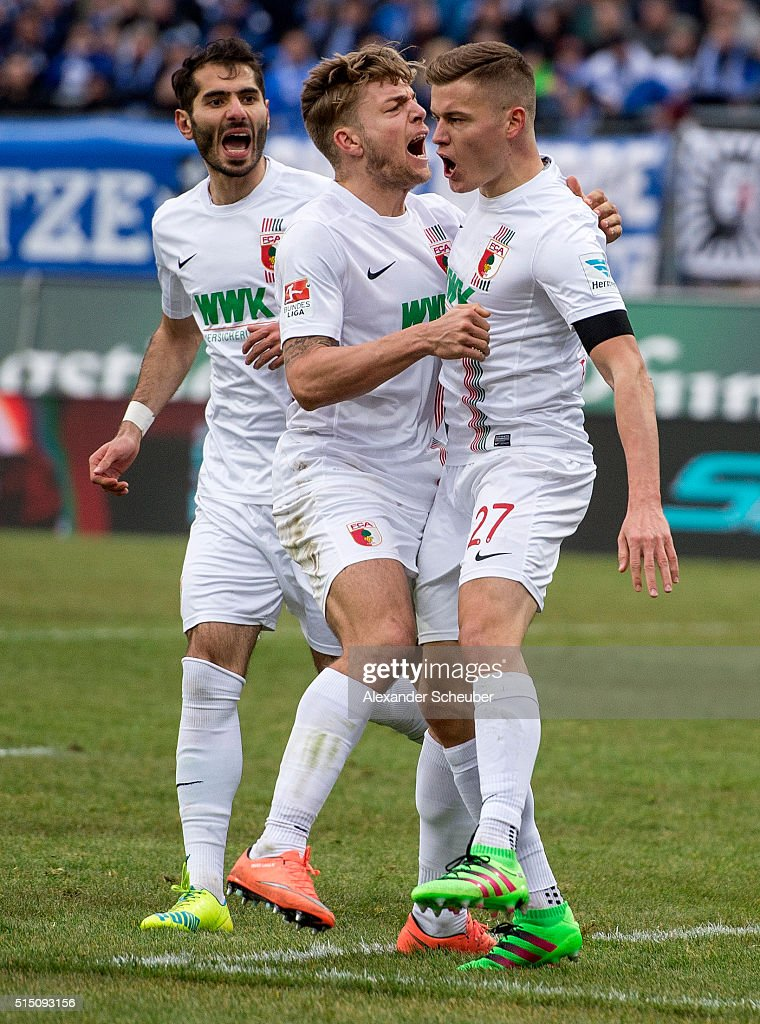 Alfred Finnbogason of FC Augsburg celebrates the second goal for his team with a penalty with Alexander Esswein of FC Augsburg (m) and Halil Altintop of FC Augsburg (l) during the first bundesliga match between SV Darmstadt 98 and FC Augsburg at Merck-Stadion am Boellenfalltor on March 12, 2016 in Darmstadt, Germany.