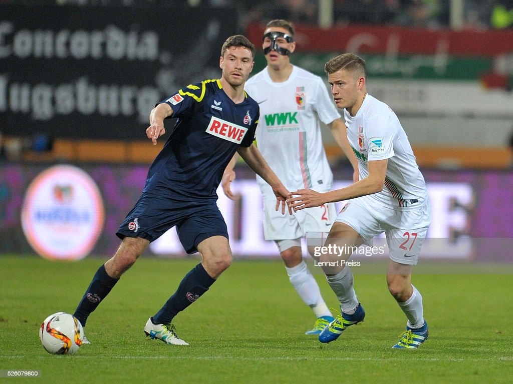 Alfred Finnbogason (R) of FC Augsburg challenges <a gi-track='captionPersonalityLinkClicked' href=/galleries/search?phrase=Jonas+Hector&family=editorial&specificpeople=8121522 ng-click='$event.stopPropagation()'>Jonas Hector</a> of 1. FC Koeln during the Bundesliga match between FC Augsburg and 1. FC Koeln at WWK Arena on April 29, 2016 in Augsburg, Germany.
