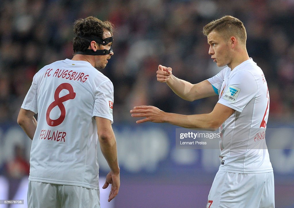 Alfred Finnbogason (L) of FC Augsburg talks to his teammate <a gi-track='captionPersonalityLinkClicked' href=/galleries/search?phrase=Markus+Feulner&family=editorial&specificpeople=623655 ng-click='$event.stopPropagation()'>Markus Feulner</a> during the Bundesliga match between FC Augsburg and 1. FC Koeln at WWK Arena on April 29, 2016 in Augsburg, Germany.
