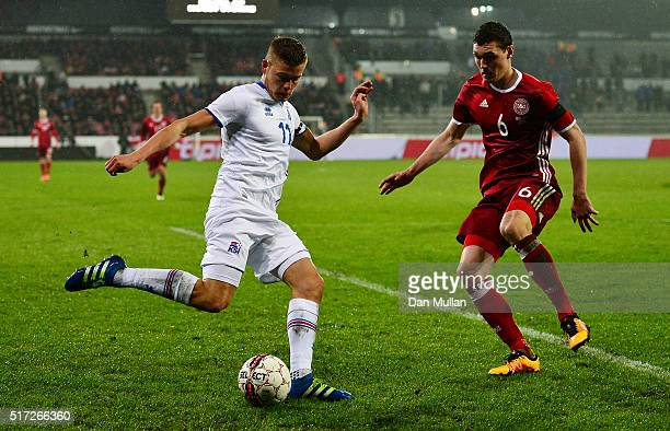 Alfred Finnbogason of Iceland attempts to cross the ball under pressure from Andreas Christensen of Denmark during the International Friendly match...
