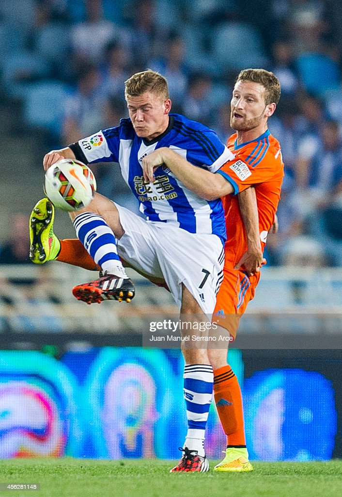Alfred Finnbogason of Real Sociedad duels for the ball with <a gi-track='captionPersonalityLinkClicked' href=/galleries/search?phrase=Shkodran+Mustafi&family=editorial&specificpeople=5006425 ng-click='$event.stopPropagation()'>Shkodran Mustafi</a> of Valencia CF during the La Liga match between Real Sociedad and Valencia CF at Estadio Anoeta on September 28, 2014 in San Sebastian, Spain.